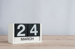 March 24th. Day 24 of month, wooden calendar on light background. Spring time, empty space for text Royalty Free Stock Photo