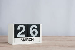 March 26th. Day 26 of month, wooden calendar on light background. Spring time, empty space for text Royalty Free Stock Image