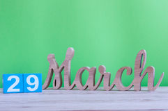 March 29th. Day 29 of month, daily wooden calendar on table and green background. Spring time, empty space for text. March 29th. Cube calendar for march 29 on Royalty Free Stock Images