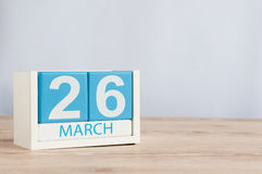 March 26th. Day 26 of month, wooden color calendar on table background. Spring time, empty space for text Royalty Free Stock Photos