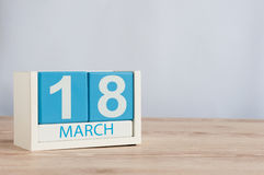 March 18th. Day 18 of month, wooden color calendar on table background. Spring time, empty space for text Stock Image