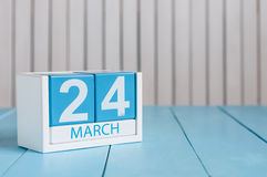 March 24th. Image of march 24 wooden color calendar on white background.  Spring day, empty space for text Stock Photo