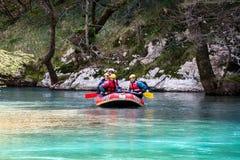 March 27th 2011 Konitsa, Greece - Rafting in Voidomatis river, Epirus, Greece, under an old stone bridge Stock Photo