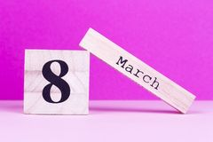 March 8th on pink background. March 8th wooden calendar. March holiday of lovely mom royalty free stock photos