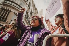 MALAGA, SPAIN - MARCH 8, 2018: Thousands of women take part in the Feminist Strike on the Women Day in the city center of Malaga. Royalty Free Stock Photography