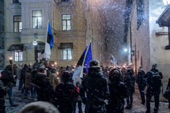 March of the torches on Estonia's independence Day. Hundreds of people brave snow and storms to take part in march of the torches organised by royalty free stock photos