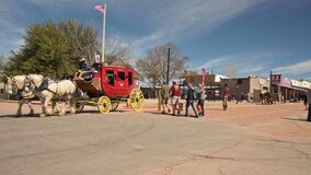 Tourists riding in the horse carriage on the famous Allen street in Tombstone, Arizona