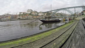 March 06, 2017 - Traditional Portuguese boats on Douro river, City of Porto, Portugal. Panoramic view with birds.  stock video