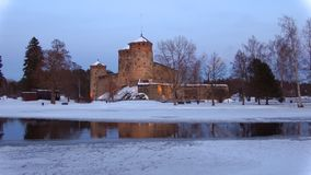 March twilight at the ancient fortress Olavinlinna. Savonlinna, Finland. March twilight at the ancient fortress Olavinlinna. Savonlinna. Finland stock video