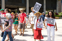 March of Union Workesr's Rights Supporters. Supporter holding signs that says Unions Make Us Strong  march in solidarity at a rally at the Hawaii State Capitol Royalty Free Stock Photo