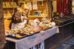 MARCH 25, 2016:  Woman selling traditional gingerbread baked goods at traditional Easter markets on Old Towns Square in Prague, Cz Stock Images