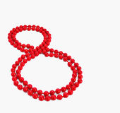 March 8 Women`s Day celebration figure 8 red beads decoration clipart. March 8 Women`s Day celebration figure 8 red beads decoration Stock Photo