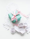 8 march, women`s day. A gift on a white napkin and white paper flowers Stock Image