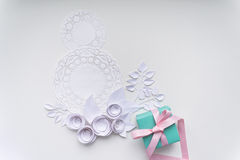 8 march, women`s day. A gift on a white napkin and white paper flowers Stock Images