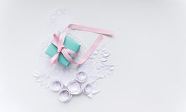 8 march, women`s day. A gift on a white napkin and white paper flowers Stock Photos