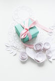 8 march, women`s day. A gift on a white napkin and white paper flowers Stock Photography