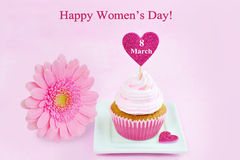 March 8 Women's Day pink greeting card with cupcake, heart and gerbera daisy. Stock Photography