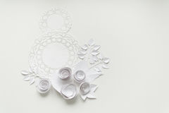 8 march, women`s day. A white napkin and white paper flowers Royalty Free Stock Images