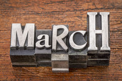 March word in metal type. March word in mixed vintage metal type printing blocks over grunge wood Stock Image