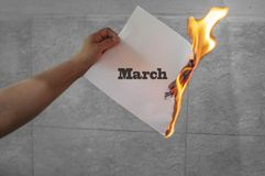 March word text on fire with burning paper. In hand royalty free stock photos