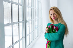 8 march, young beautiful woman with tulips. Royalty Free Stock Images