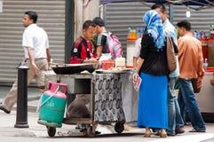 Marchand ambulant en Malaisie Images libres de droits