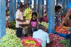 Marchand ambulant local vendant des légumes Image libre de droits