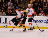 Marchand grabs ahold of Ville Leino. Royalty Free Stock Photos