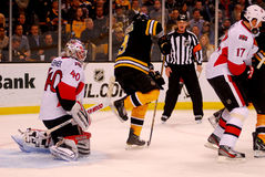 Marchand screens Lehner (NHL Hockey) Royalty Free Stock Photography