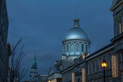 Marche Bonsecours in Montreal, Quebec, Canada, during a winter evening, surrounded by other historical buildings. stock photography