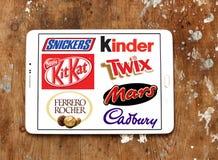Marche e logos del cioccolato Fotografia Stock