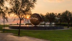 Sunrise on the waterfront of Pesaro. Marche region, Italy - Sunrise on the waterfront of Pesaro. HDRnsculpture by Arnaldo Pomodoro at sunrise called `Tomato`s royalty free stock image