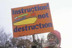 Marcher promoting education vs. destruction Stock Images