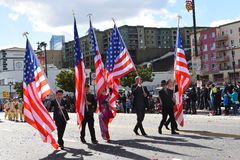 Marchers carrying American Flags at the Los angeles Chinese New Year Parade stock photo