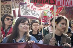 Marchers hold up signs saying `This planet is for all creatures` and `Vegan because I respect someone else`s life. Moscow, RUSSIA - MAY 1, 2019: Marchers hold up royalty free stock photo