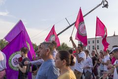 Marchers holding national flags in the party in Tairna ,Albania in. Marchers holding national flags in the party are taken in Tairna ,Albania in Royalty Free Stock Image