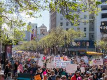 Marchers at March for Our Lives rally in traverse down Market St. SAN FRANCISCO, CA - MARCH 24, 2018: Marchers at March for Our Lives rally in traverse down Stock Photography