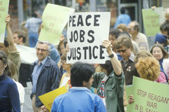 Marchers at peace rally holding signs, Los Angeles, California Stock Photo