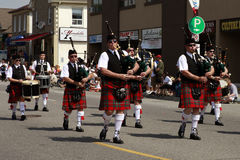 Marching bagpipes band Stock Images