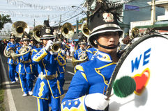 Marching band. Picture of a competing band during a town annual fiesta street parade in Silang Cavite Philippines. Many tourists watch this with excitement Royalty Free Stock Photography