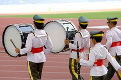 Marching Band. Boys marching band performing at a stadium in Kuala Lumpur, Malaysia royalty free stock photo