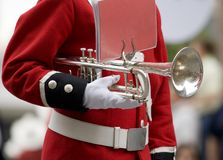 Marching band. Member of marching band holds trumpet between songs stock image
