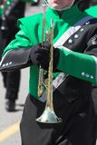 Marching Band. St. Patrick's day parade with marching band, girl waiting to play instrument royalty free stock image