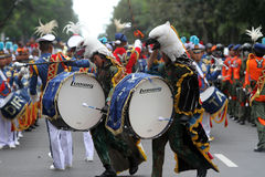 Marching band. Air Force Academy marching band in action on the streets during a parade in the city of Solo, Central Java, Indonesia Stock Images