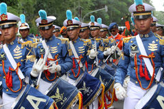 Marching band. Air Force Academy marching band in action on the streets during a parade in the city of Solo, Central Java, Indonesia Stock Photos