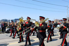 Marching Band in the Battle of York Parade. TORONTO, CANADA - APRIL 27: Marching band in the military parade in downtown Toronto that marks the 200th anniversary Royalty Free Stock Images