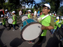 Marching band. Children elementary school students participate in the competition marching band in the city of Solo, Central Java, Indonesia Stock Images