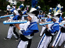 Marching band. Children are following the marching band competition between schools in the city of Solo, Central Java, Indonesia Royalty Free Stock Image