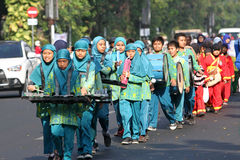 Marching band. Children were practicing marching band on the street in the city of Solo, Central Java, Indonesia Stock Photos
