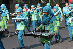 Marching band. Children were practicing marching band on the street in the city of Solo, Central Java, Indonesia Stock Photography
